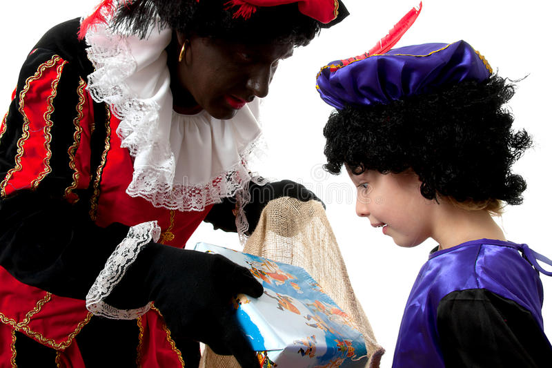Download Zwarte Piet ( Black Pete) With Young Chi Stock Image - Image: 16528713