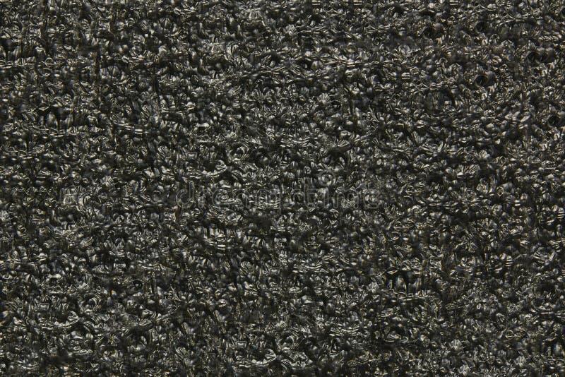 Zwarte polyurethaanachtergrond Textuur in de vorm van samen gelijmde ballen royalty-vrije stock foto's