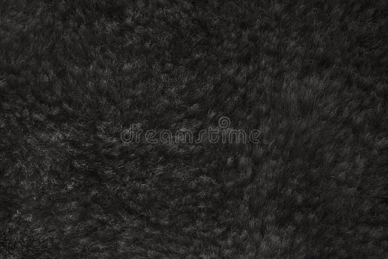 Zwarte ruwharige huid van een dierlijke close-uptextuur, Bonttextuur stock afbeelding