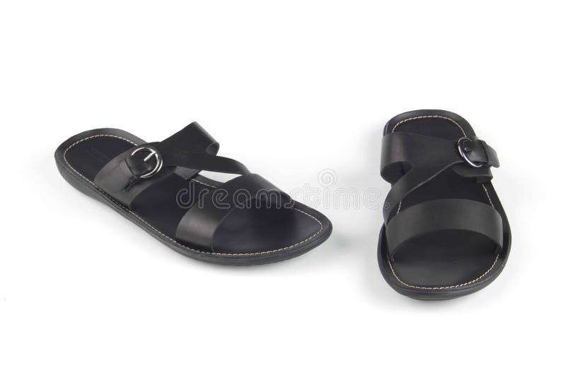 Zwarte sandals van het kleurenleer stock foto