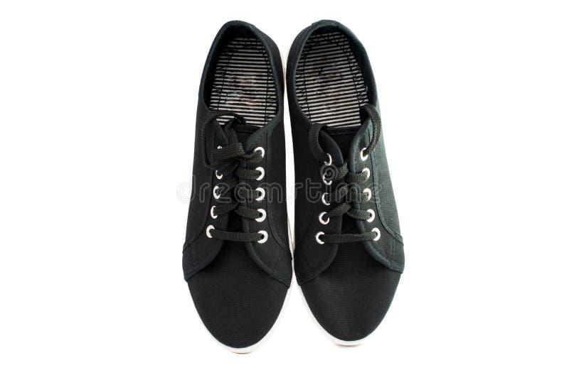 Zwarte sportenschoenen stock foto