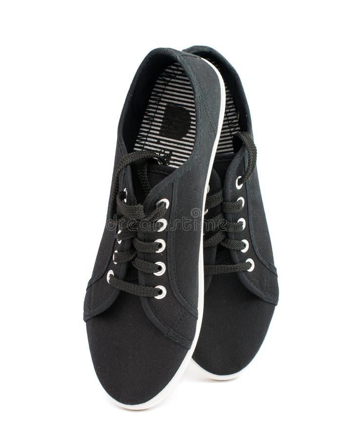 Zwarte sportenschoenen stock afbeeldingen
