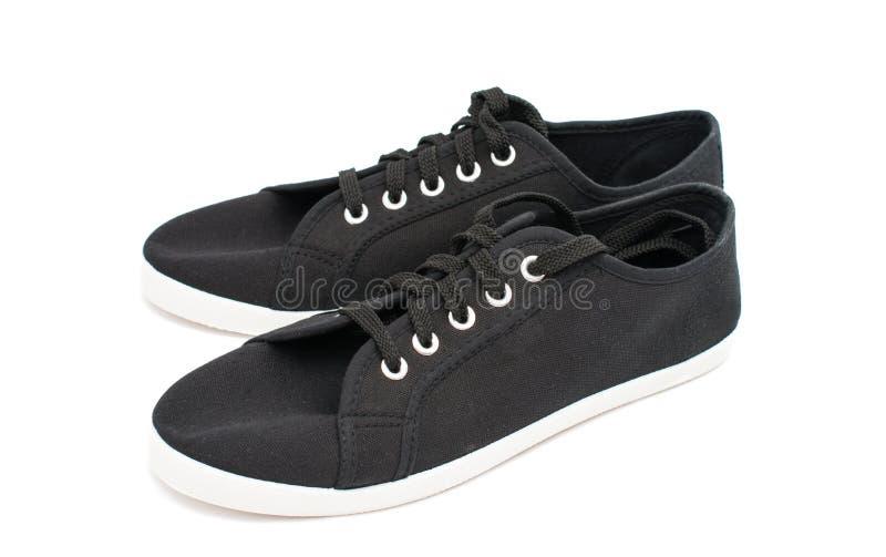 Zwarte sportenschoenen stock afbeelding
