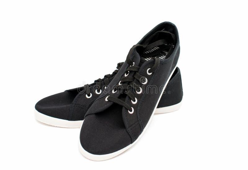 Zwarte sportenschoenen royalty-vrije stock afbeelding