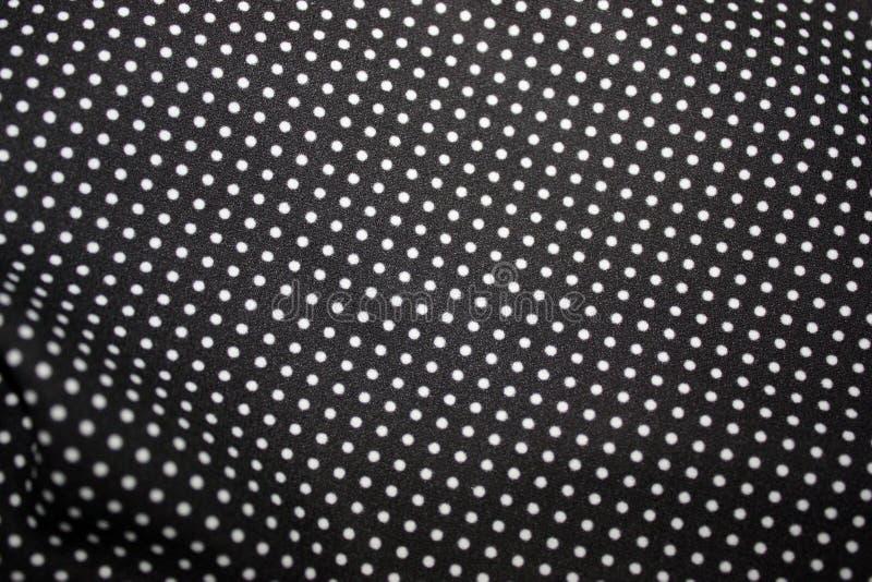 Zwarte stof en witte uiterst kleine stipachtergrond, close-up royalty-vrije stock foto's