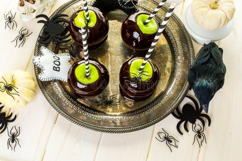 Zwarte suikergoedappelen stock foto