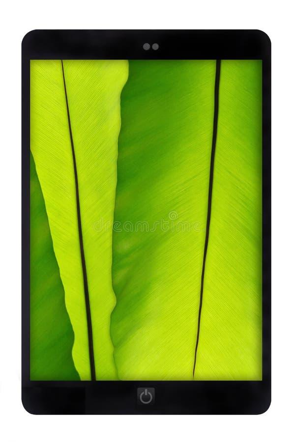 Zwarte tablet met groene bladmuur royalty-vrije stock foto
