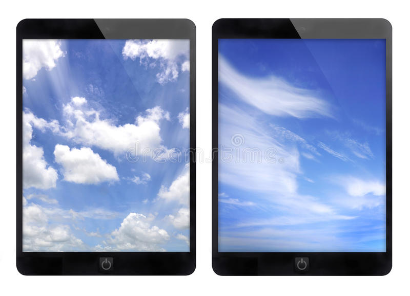 Zwarte tablet twee en blauwe hemelachtergrond royalty-vrije stock foto's