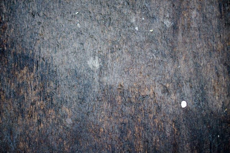 Zwarte teer behandelde dakclose-up stock afbeelding