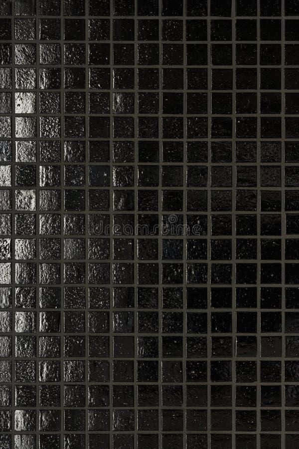 Zwarte tegelachtergrond stock afbeelding