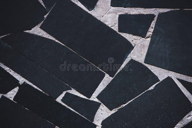 zwarte tegelsachtergrond royalty-vrije stock afbeelding
