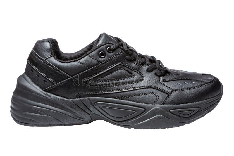 Zwarte tennisschoenen voor dagelijkse slijtage, de schoenen van het sportenleer, levensstijl royalty-vrije stock foto
