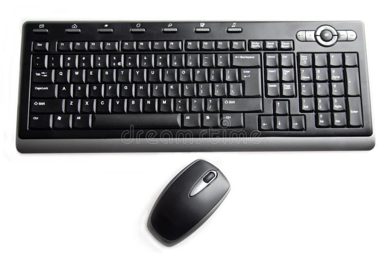 Zwarte toetsenbord en muis stock foto's