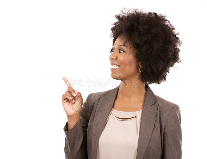Zwarte toevallige vrouw op witte achtergrond royalty-vrije stock afbeelding