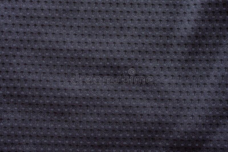 Zwarte van de de kledingsvoetbal van de stoffensport de textuurachtergrond van Jersey royalty-vrije stock foto
