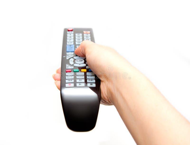 Zwarte verre in hand van TV stock foto
