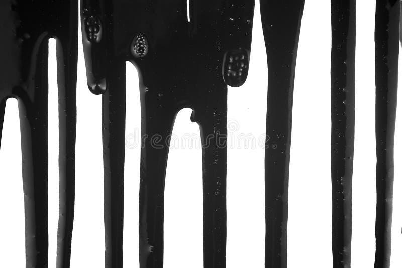 Zwarte Vloeistof die 1 druipt royalty-vrije stock foto