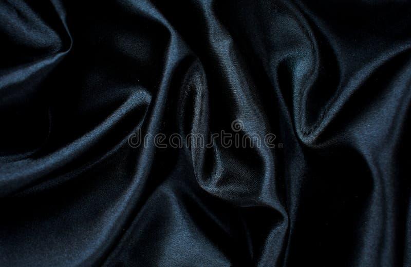 Zwarte zijde achtergrondtextuur materiële lege schoonheid stock afbeelding