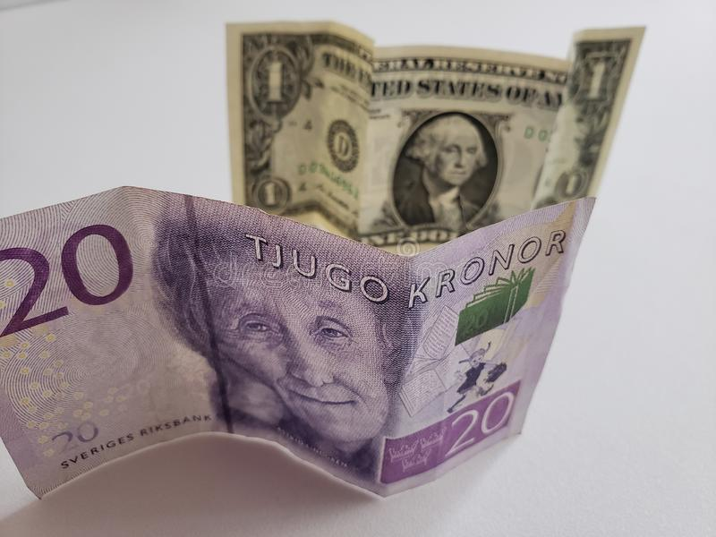 Zweeds bankbiljet van kronor twintig en Amerikaanse dollarrekening royalty-vrije stock afbeelding