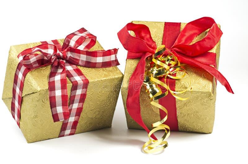 Download Zwei anwesende Pakete stockbild. Bild von geschenk, decorate - 27727487