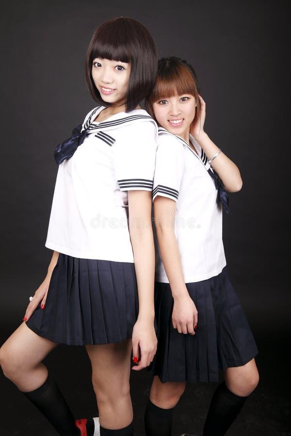 Zwei asiatische Schulmädchen lizenzfreie stockbilder