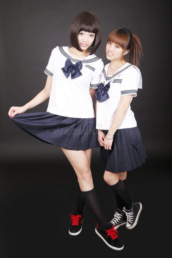 Zwei asiatische Schulmädchen stockfoto