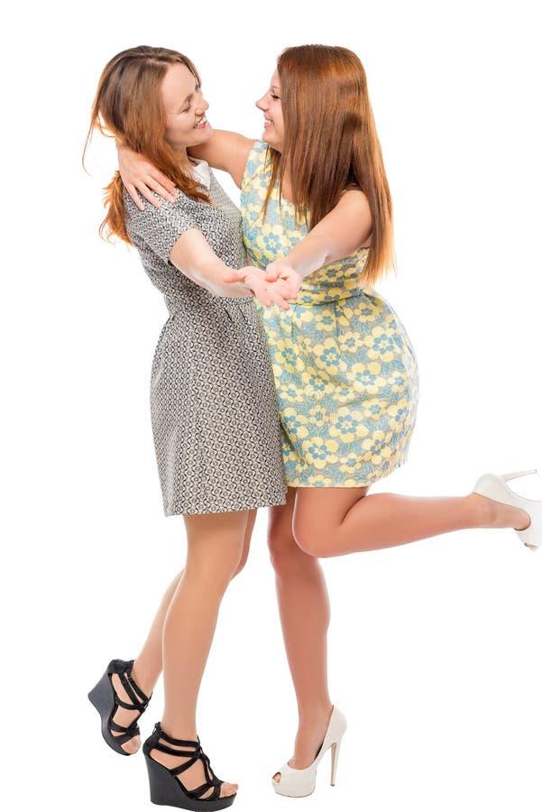 Zwei beste Freunde tanzen auf einen weißen Hintergrund stockbild