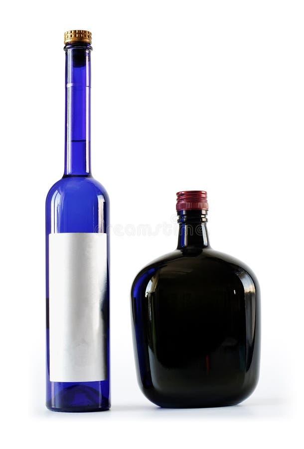 Zwei Flaschen - stark und dünn stockfotos