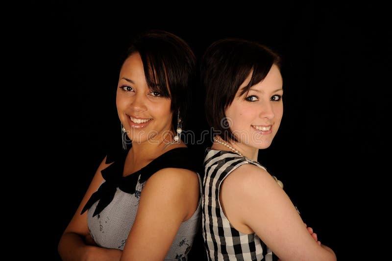 Zwei Frauen Wechsel stockfotografie