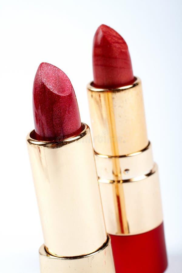 Zwei Gefäße roter Lippenstift lizenzfreie stockfotos