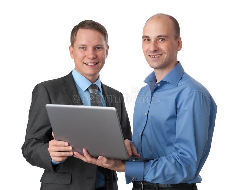 Zwei Geschäftsleute mit Laptop-Computer stockbild