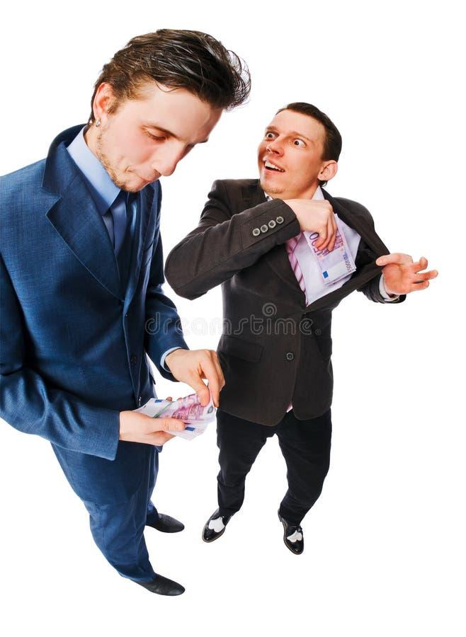 Zwei Geschäftsmänner mit Lots Bargeld lizenzfreie stockfotos