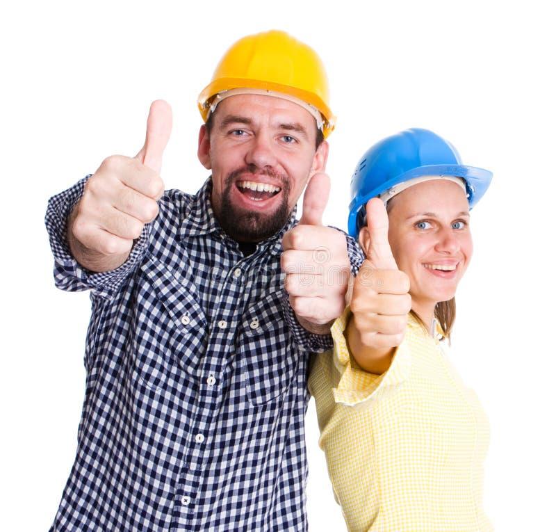 Zwei glückliche Architekten oder Erbauer stockfotografie