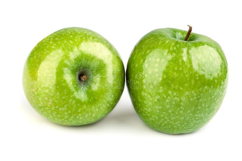 Zwei grüne Äpfel auf einem weißen Hintergrund stockfotografie