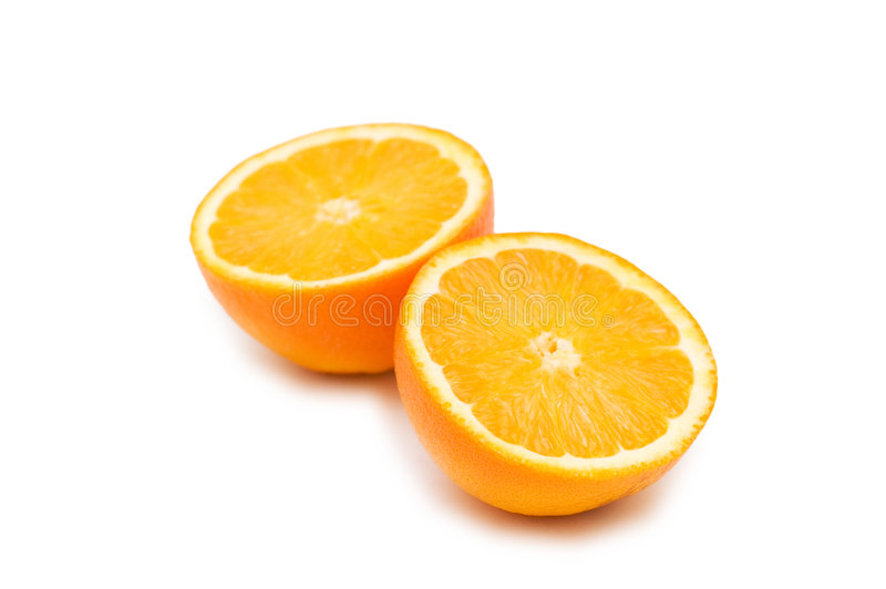 Zwei Hälfte-schnitten die getrennten Orangen stockbild