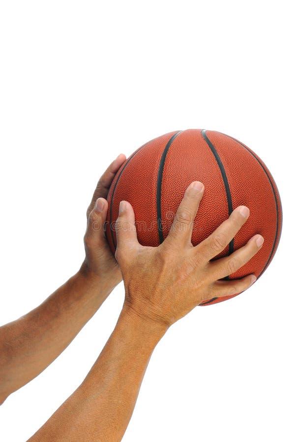 Zwei Hände und Basketball stockbild