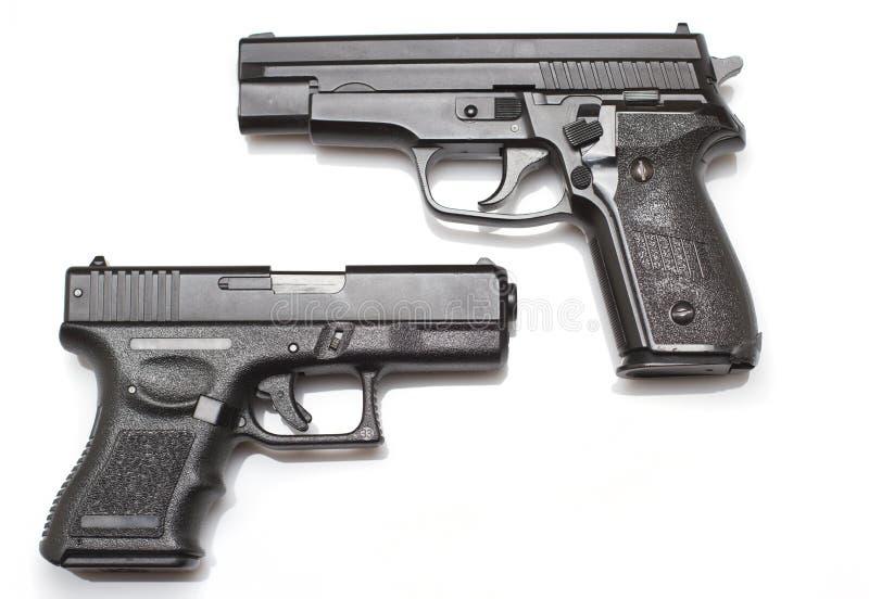 Zwei Handgewehren stockbild