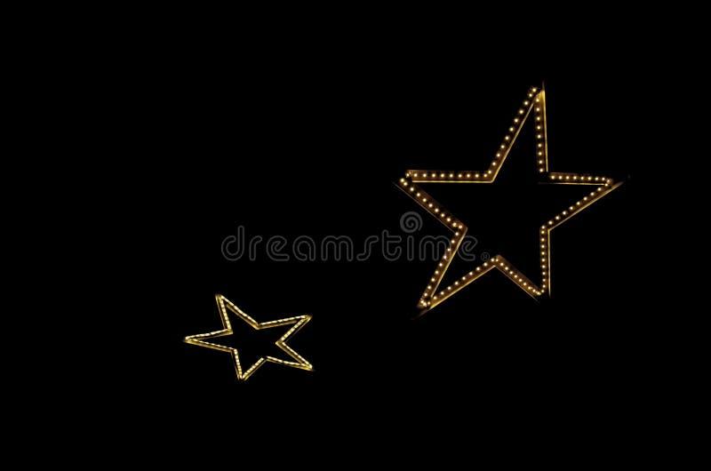 Zwei helle elektrische Sterne lizenzfreies stockbild