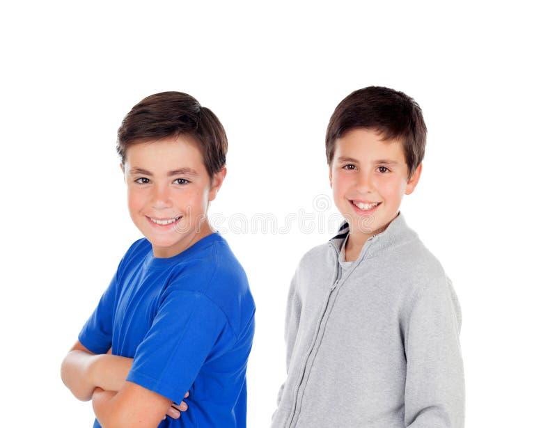 Zwei Jugendlichjungen, die Kamera betrachten lizenzfreie stockbilder