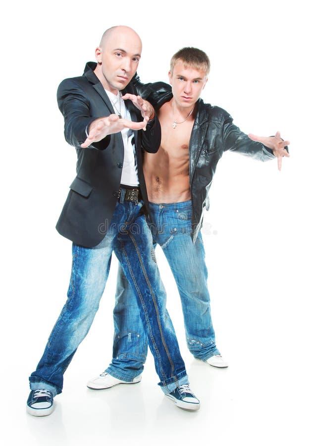 Zwei junge Männer in den Jeans lizenzfreie stockbilder