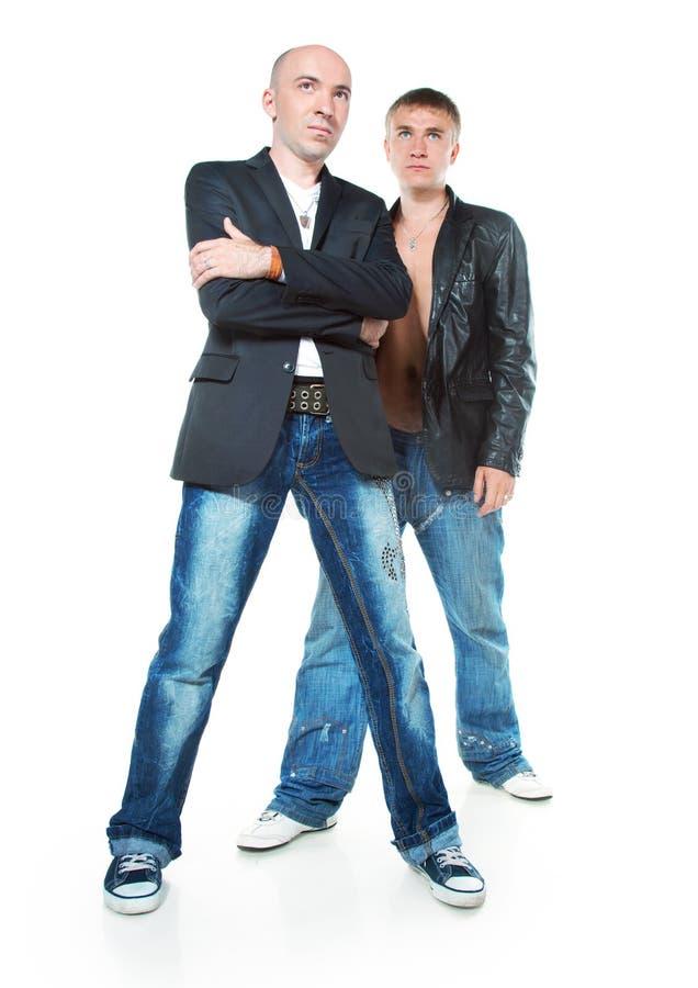 Zwei junge Männer in den Jeans lizenzfreies stockbild