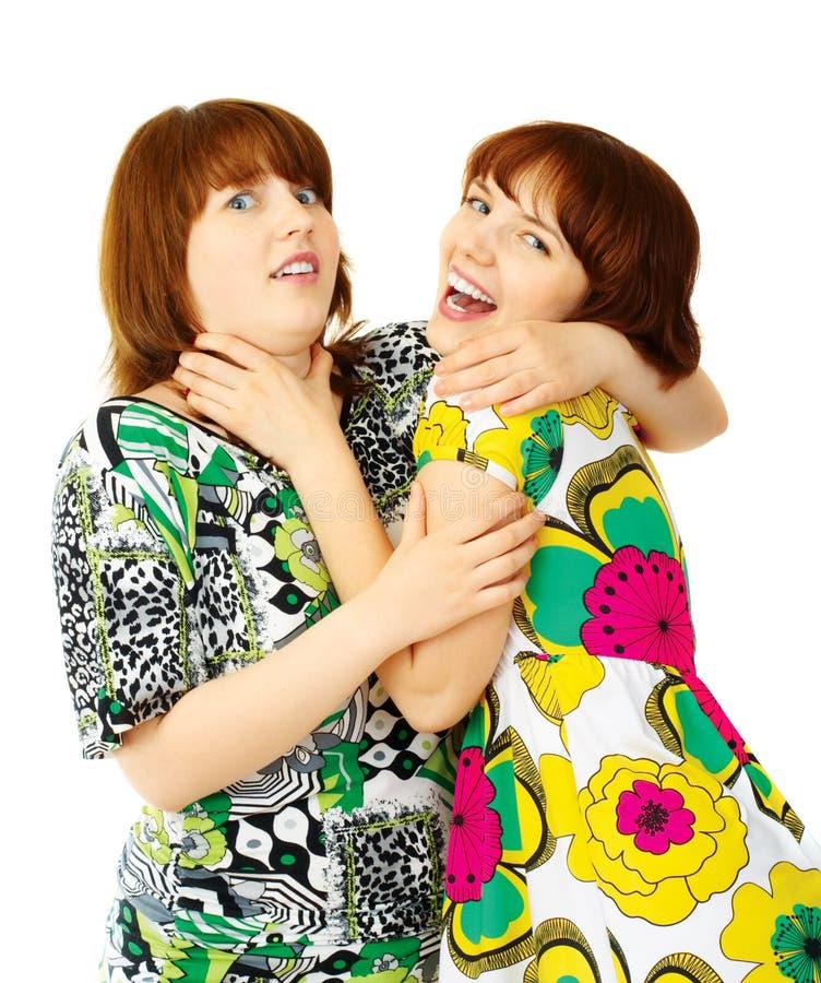Zwei junge spielende Mädchen stockfotos