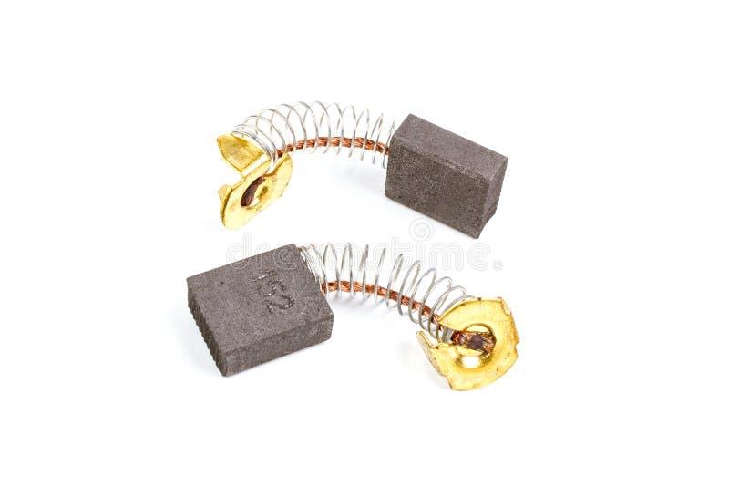 Zwei Kohlebürsten für den elektrischen Ersatz-Motor lokalisiert auf wh stockfotografie