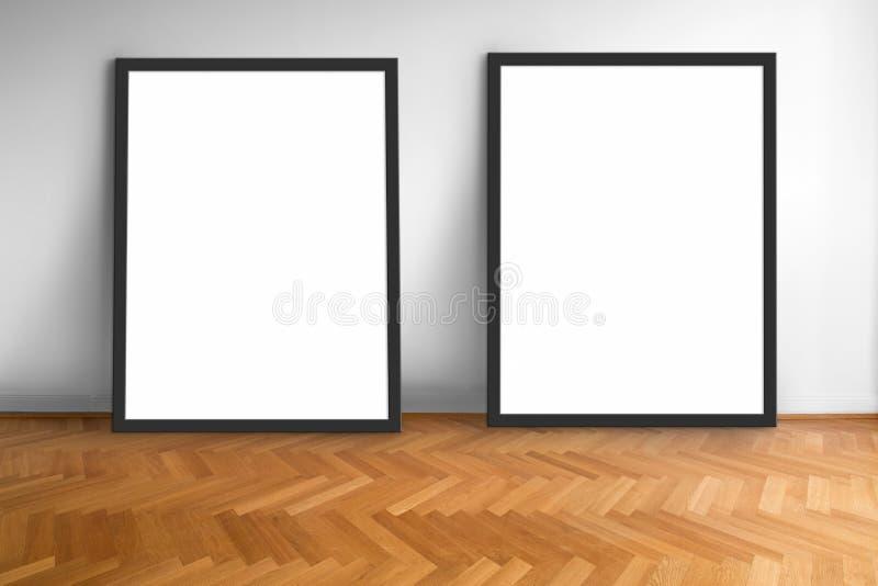 Zwei leere Bilderrahmen auf weißem Wandhintergrund des hölzernen Parkettbodens, leerer Rahmen stockfotografie