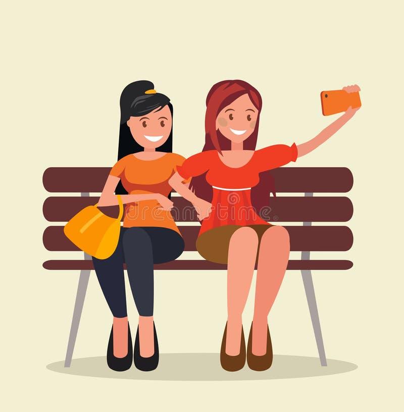 Zwei Mädchen sitzen auf einer Bank und nehmen selfies lizenzfreie abbildung