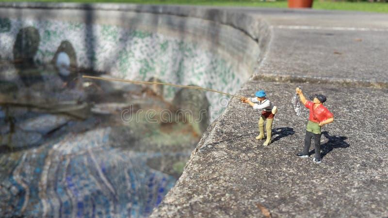 Zwei-mann- und ein Fisch stockbilder
