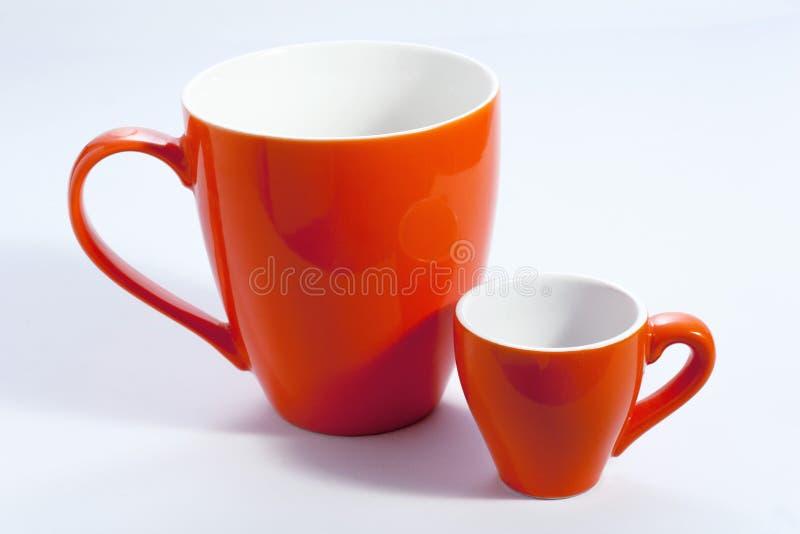 Zwei orange Becher stockfotografie