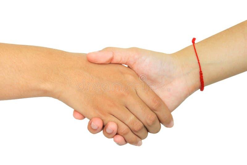 Zwei Personen, die Hände auf weißem Hintergrund rütteln stockfotos