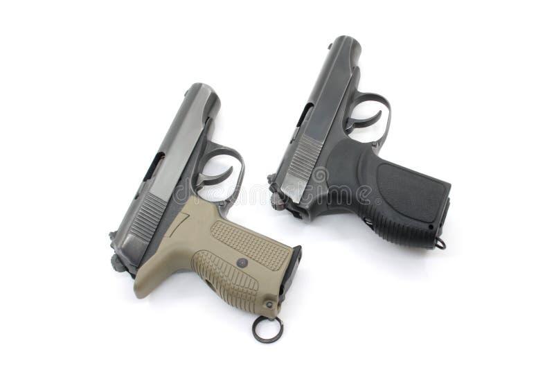 Zwei Pistolen auf einem weißen Hintergrund stockfoto