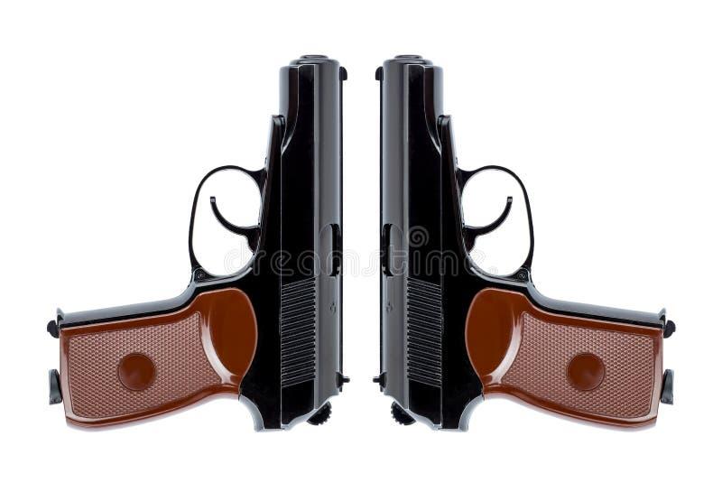 Zwei Pistolen symmetrisch verwiesen hinunter die St?mme stockfoto